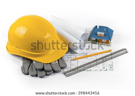 house construction project - tools and equipment on blueprints - stock photo