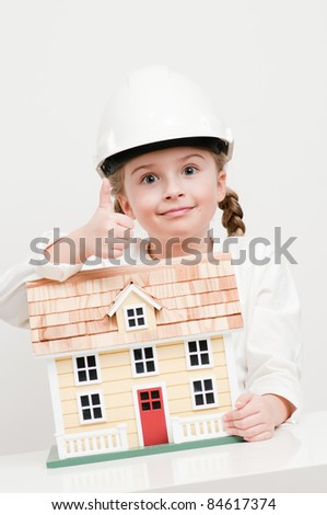 House constructor - Little girl with house model - stock photo