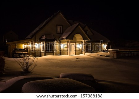 house covered by snow during winter time - stock photo