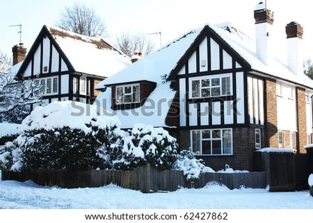 House covered in snow in winter - stock photo