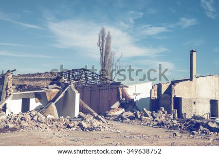 House demolition. Ruin of a old demolished house. Made with vintage style. - stock photo