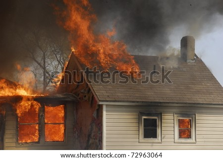 house destroyed by fire - stock photo