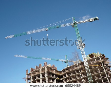 house develop at day with crane - stock photo