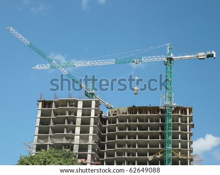 house develop at day  with crane  in city - stock photo