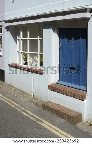 House doorway shortened to prevent flooding from high tides in Bosham. West Sussex. England - stock photo
