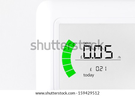 House energy meter showing the cost per hour for electricity usage - stock photo