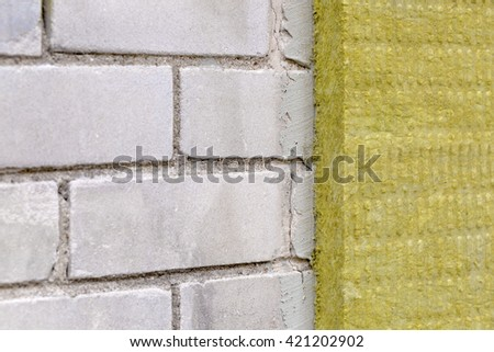 house exterior insulation with mineral rock wool - stock photo