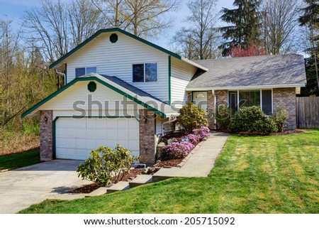 House exterior. View of driveway and landscape on front yard - stock photo