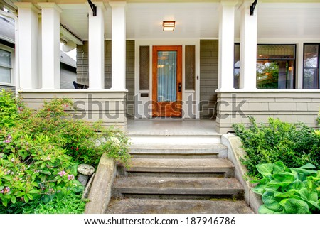 House exterior view of entrance column porch with stairs stock