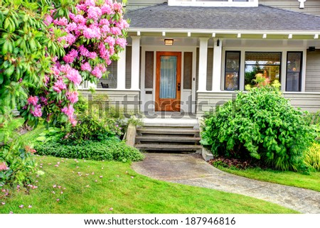 House exterior. View of entrance column porch with stairs and walkway. - stock photo