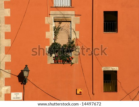 house facade in europe, mediterranean style, warm colors - stock photo