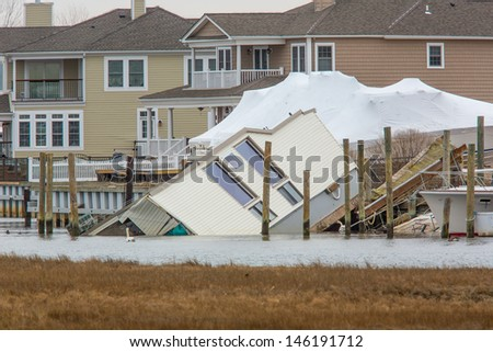 House Fallen into Bay in Nassau County after Hurricane Sandy - stock photo