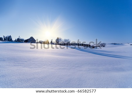 house field and sun in winter - stock photo