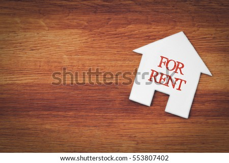 house for rent symbol with wood background