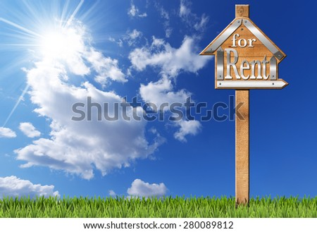 House For Rent - Wooden Sign with Pole. Wooden and metallic sign in the shape of house with text for rent and wooden pole. For rent real estate sign on blue sky with clouds, sun rays and green grass - stock photo