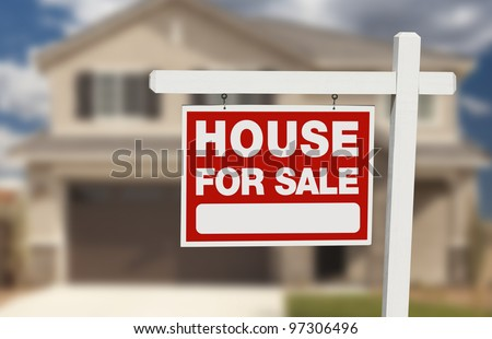 House For Sale Real Estate Sign in Front of Beautiful New Home. - stock photo