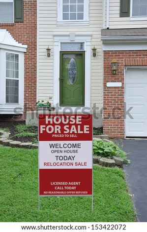 House for Sale Real Estate Sign on front yard lawn of Suburban home USA - stock photo