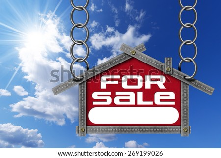 House For Sale Sign - Metallic Meter. Grey metallic meter ruler in the shape of house with text for sale. For sale real estate sign on blue sky with clouds and sun rays - stock photo