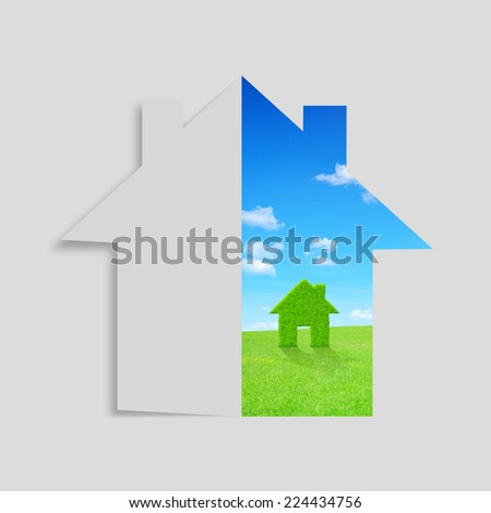 House from paper on the background meadow with green house symbol