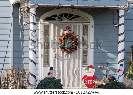 House Front Porch with Christmas Decorations, Santa Claus, Snowman, Wreath and Candy Canes