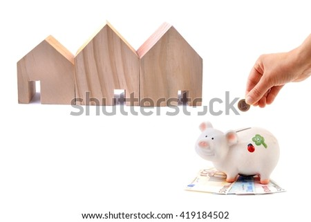 House. House with money. House. House and Hand dropping coin into the moneybox. House. House buy.  House sell. House. House and money. Concept of saving for buy home.House. - stock photo