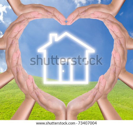 house icon in hands heart