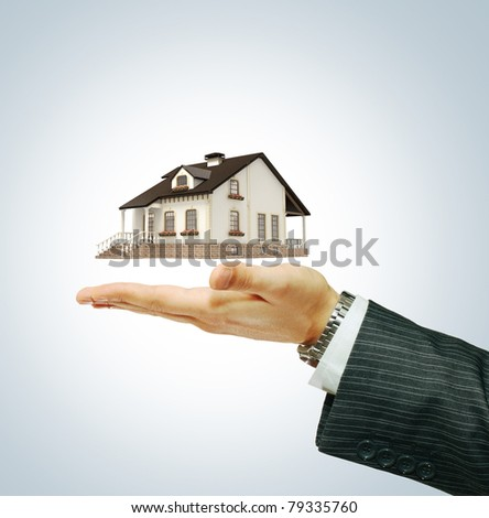 House in businessman's hand - stock photo