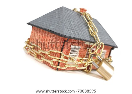 House in chains - stock photo