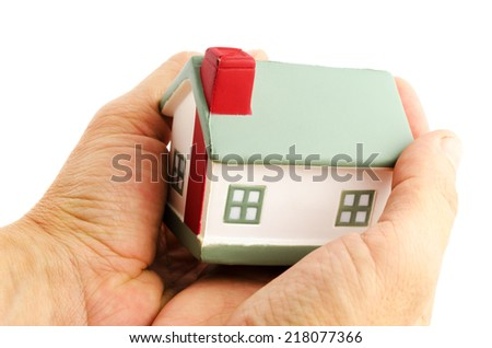 house in hands isolated on white background - stock photo