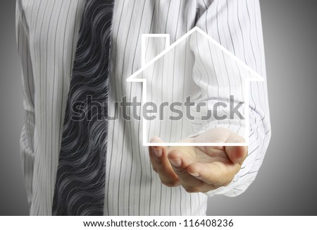 house in human hands Business man - stock photo