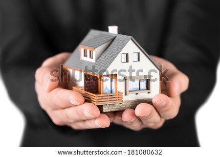 House in man's hands - stock photo