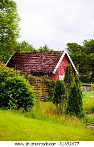 house in the garden - stock photo