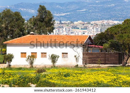 house in the meadow overlooking the city.  - stock photo