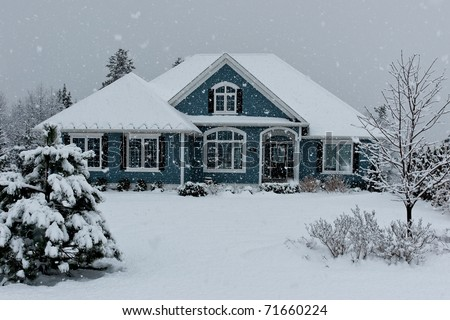 House in winter snow storm - stock photo