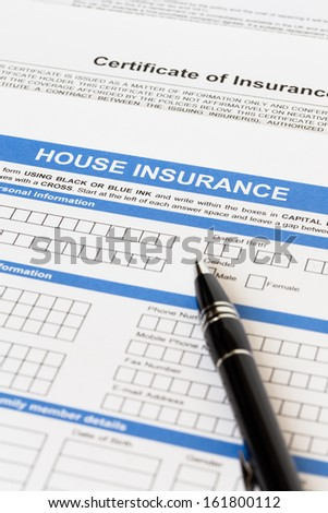 House insurance application with pen - stock photo