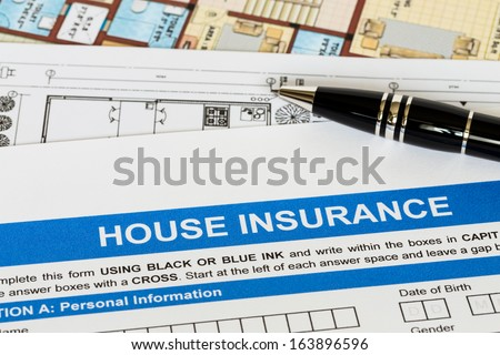 House insurance application with pen and construction plan - stock photo
