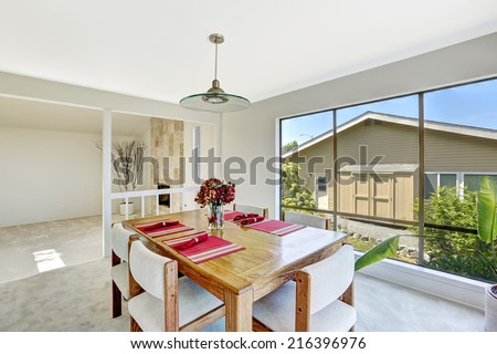 House interior. Bright room with dining table set and beautiful window view