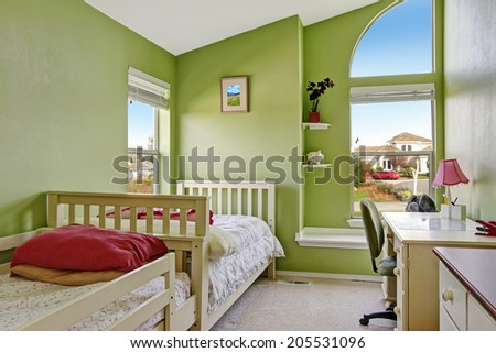 House interior. View of entrance hall with small office area with attached desk to wall - stock photo