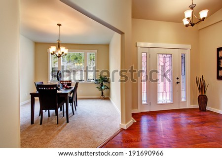 House interior. View of entrance hallway and dining area with served table - stock photo