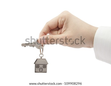House key in hand with clipping path