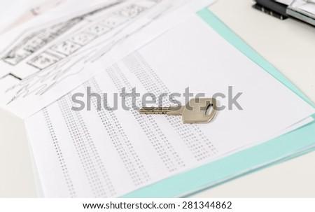house key on amortization schedule closeup stock photo 281344862