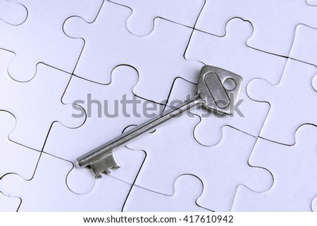 House key on jigsaw puzzle pieces - stock photo