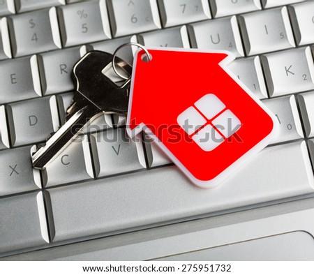 House key on laptop keyboard - stock photo