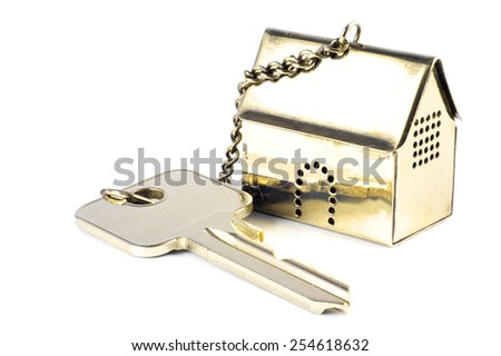 house key with a golden model house as keychain, isolated on white background with copy space - stock photo