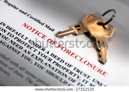 House keys and foreclosure notice - stock photo