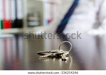 House keys on a wooden table - stock photo