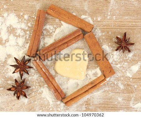 house lined with cinnamon on wooden table close-up - stock photo