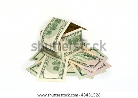 House made from hundred dollar bills on white background