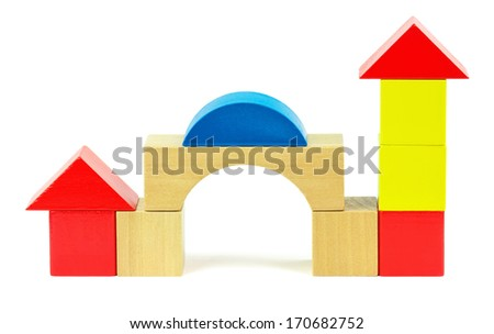 House made from toy wooden colorful building blocks on a white background  - stock photo
