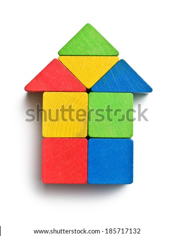 house made from wooden toy blocks on white background - stock photo